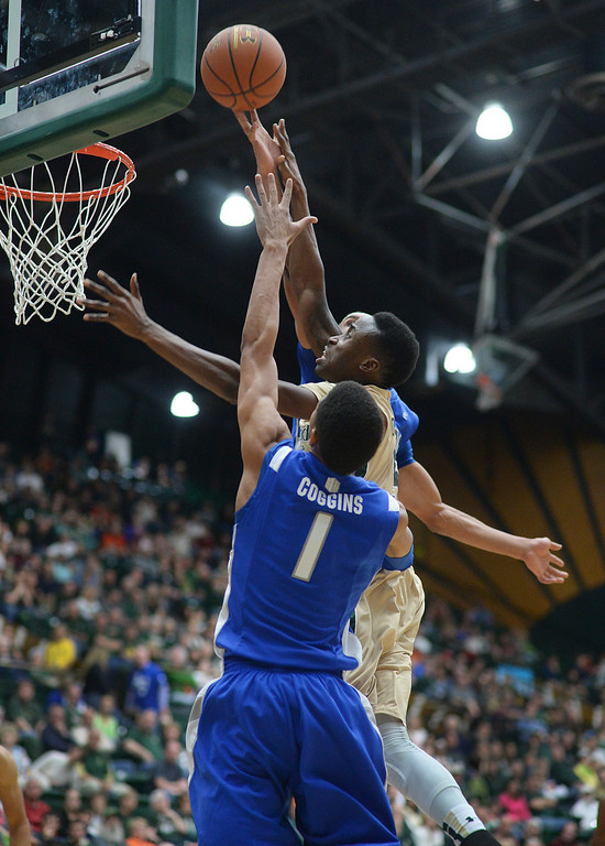 . FORT COLLINS, CO. - JANUARY 18:  Air Force junior forward Kamryn Williams (4) rejected a shot by CSU guard Jon Octeus (5) in the second half. The Colorado State men\'s basketball team defeated Air Force 74-68 at Moby Arena in Fort Collins Saturday night, January 18, 2014. Photo By Karl Gehring/The Denver Post