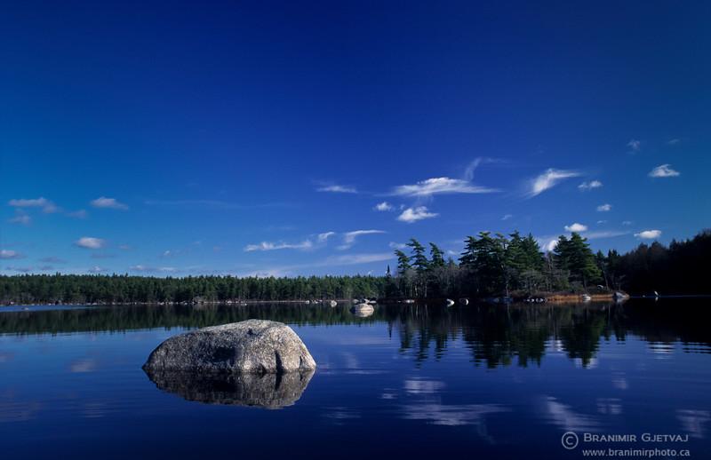 Calm lake in Kejimkujik National Park, Nova Scotia