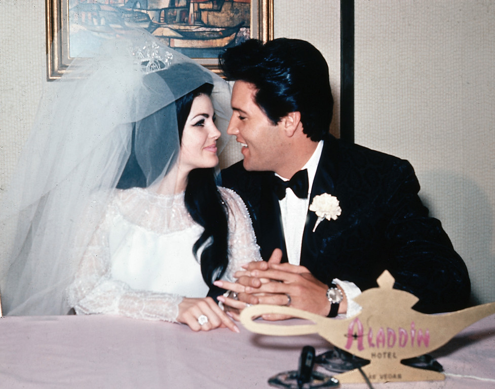 . Singer Elvis Presley and his bride, the former Priscilla Beaulieu, are shown at the Aladdin Hotel in Las Vegas, Nev., after their wedding on May 1, 1967.  Presley, 32, and Beaulieu, 21, both from Memphis, Tenn., met while he was stationed in Germany with the U.S. Army.  (AP Photo)