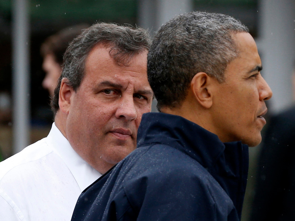 . U.S. President Barack Obama and New Jersey Governor Chris Christie look out onto a beach near the boardwalk at Point Pleasant in New Jersey, May 28, 2013.  REUTERS/Jason Reed