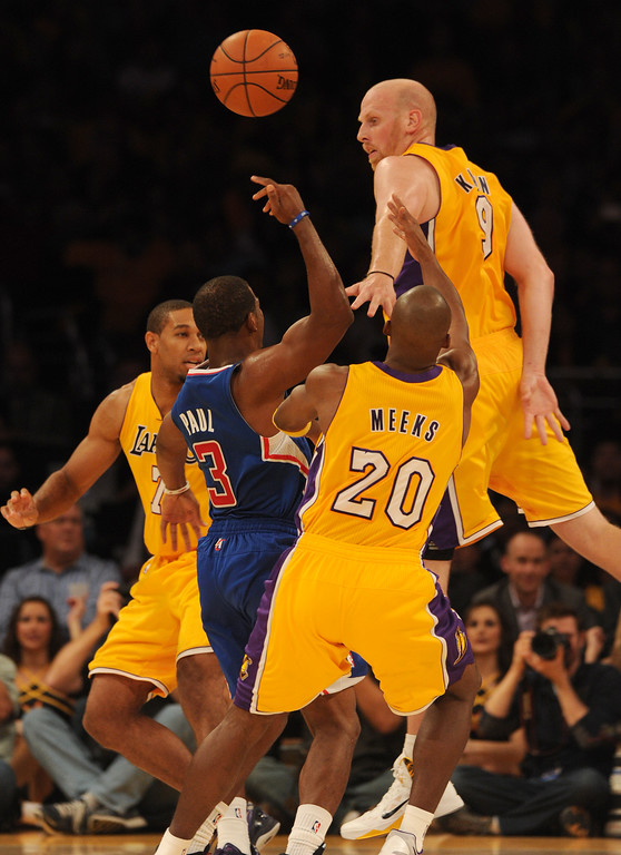 . Clippers#3 Chris Paul is blocked by Lakers Chris Kaman while attempting a shot in the 4th quarter. The Los Angeles Lakers defeated the Clippers 116 to 103 in the opening game of the season at Staples Center. Los Angeles, CA. 10/29/2013. photo by (John McCoy/Los Angeles Daily News)