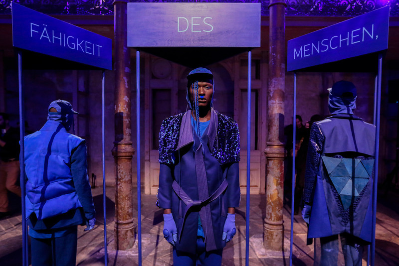 . Models present creations of Patrick Mohr\'s Autumn Winter 2014 collection during the Mercedes Benz Fashion Week in Berlin, Tuesday, Jan. 14, 2014. The words on top are part of the slogan: Freedom characterize the power of human. (AP Photo/Markus Schreiber)