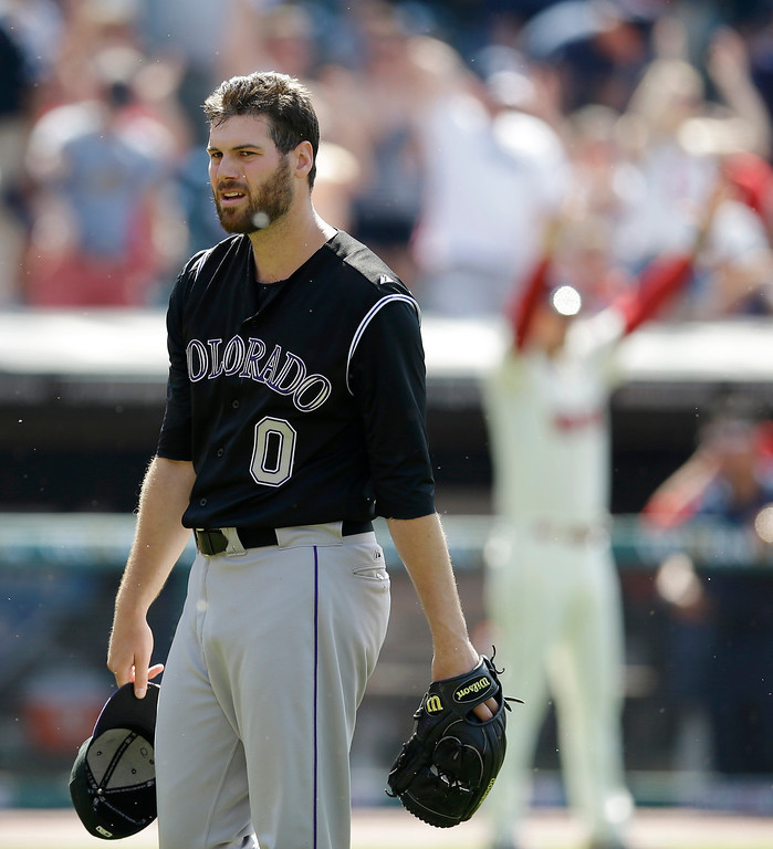 . Colorado Rockies relief pitcher Adam Ottavino (0) walks back to the dugout after giving up a two-run home run to Cleveland Indians\' Michael Bourn in the ninth inning of a baseball game on Sunday, June 1, 2014, in Cleveland. The Indians defeated the Rockies 6-4. (AP Photo/Tony Dejak)