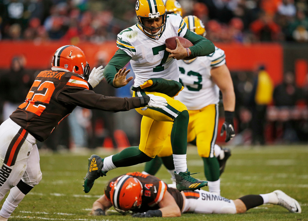 . Green Bay Packers quarterback Brett Hundley (7) avoids Cleveland Browns inside linebacker James Burgess (52) in the second half of an NFL football game, Sunday, Dec. 10, 2017, in Cleveland. (AP Photo/Ron Schwane)