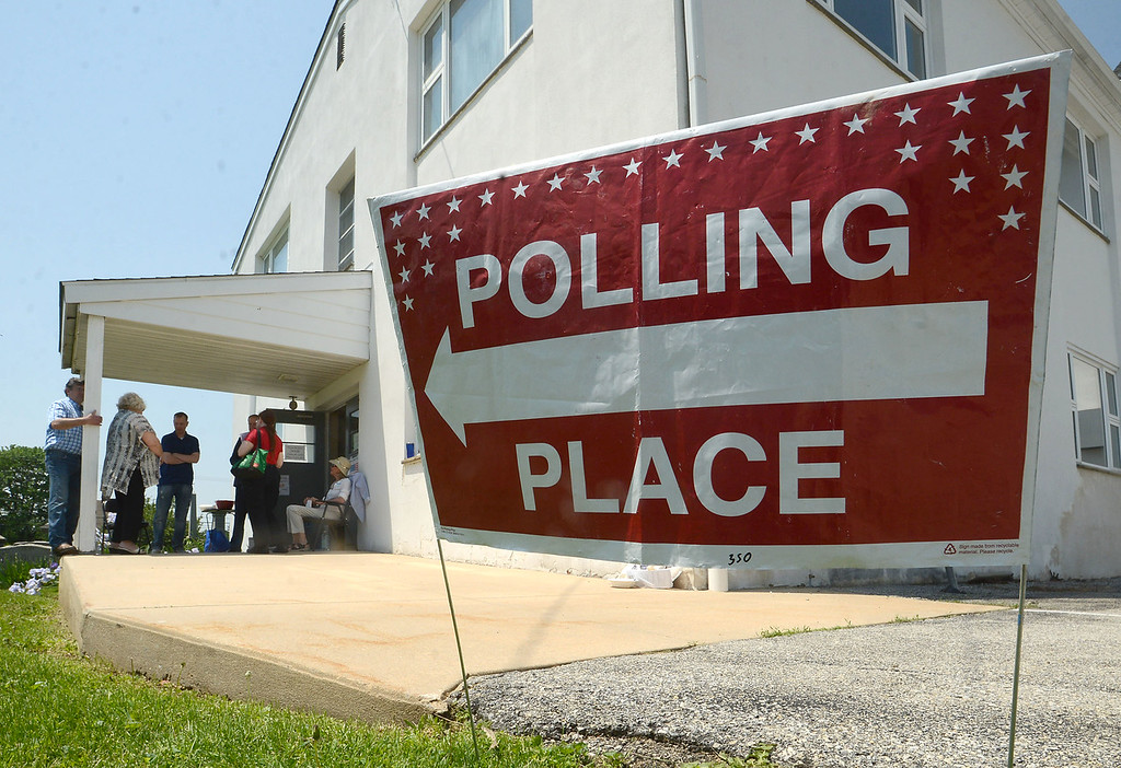 . PETE  BANNAN-DIGITAL FIRST MEDIA         Campaign workers stand outside the Malven polling place at Malvern Baptist Church Tuesday afternon.