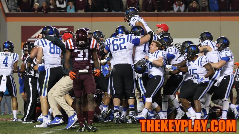 Brandon Facyson (31) walks off the field as Duke players rush the endzone after the final whistle. (Mark Umansky/TheKeyPlay.com)