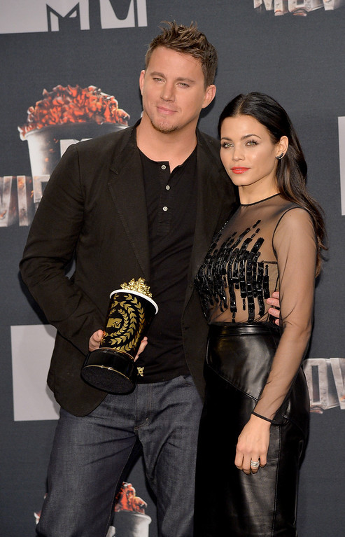 . Actor Channing Tatum (L), recipient of the MTV Trailblazer Award, and actress Jenna Dewan Tatum pose in the press room during the 2014 MTV Movie Awards at Nokia Theatre L.A. Live on April 13, 2014 in Los Angeles, California.  (Photo by Michael Buckner/Getty Images)