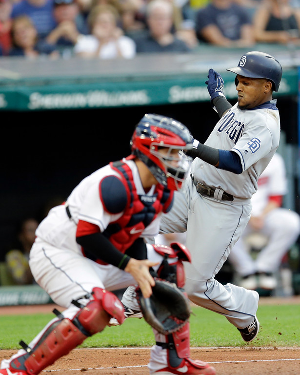 . San Diego Padres\' Erick Aybar scores as Cleveland Indians catcher Roberto Perez waits for the ball in the fourth inning of a baseball game, Wednesday, July 5, 2017, in Cleveland. Aybar scored on an RBI-single hit by Carlos Asuaje. (AP Photo/Tony Dejak)