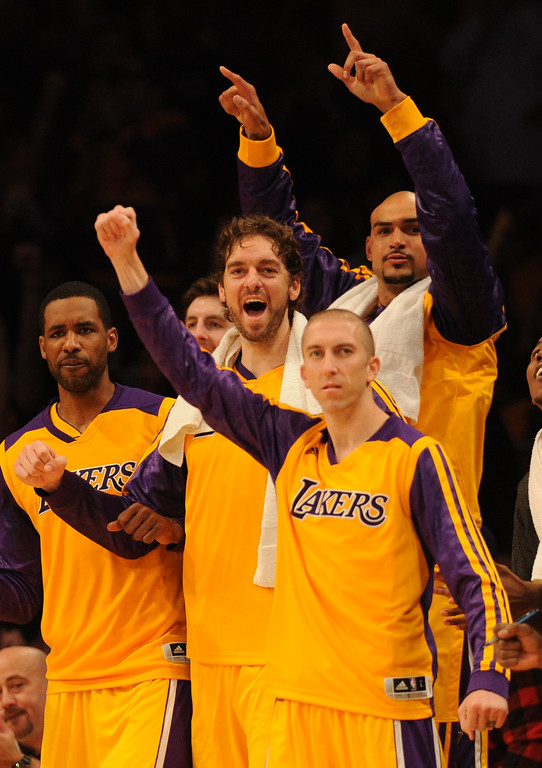 . The Laker bench celebrates in the 4th quarter. The Los Angeles Lakers defeated the Clippers 116 to 103 in the opening game of the season at Staples Center. Los Angeles, CA. 10/29/2013. photo by (John McCoy/Los Angeles Daily News)