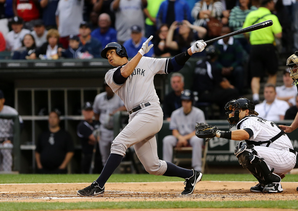 . New York Yankees\' Ale Rodriguez gets a hit in his first at bat against the Chicago White Sox in the first inning in a baseball game at US Cellular Field in Chicago on Monday, Aug., 5, 2013. (AP Photo/Charles Cherney)