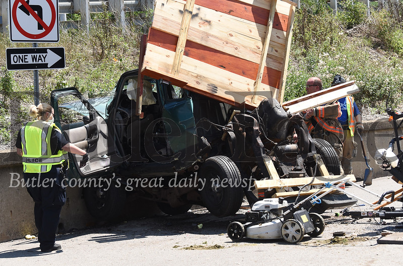 Going to be sending a few emails with these so I'm numbering them. All photos by me Captions can all be the same.A man was killed Saturday afternoon in Lyndora after the car he was a passenger in crashed into a concrete wall. The driver was severely injured.  photo 3