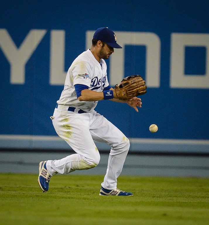 . Dodgers\' Andre Ethier can\'t find the handle on this hit Cardinals\' Yadier Molina during game action in NLCS game 3 at Dodger stadium Monday, October 14, 2013 ( Photo by Hans Gutknecht/Los Angeles Daily News )