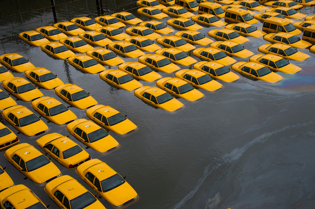 . In this Oct. 30, 2012 file photo, a parking lot full of yellow cabs is flooded as a result of superstorm Sandy in Hoboken, NJ. (AP Photo/Charles Sykes, File)