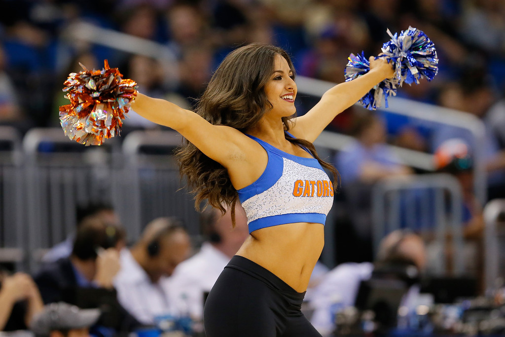 . ORLANDO, FL - MARCH 20:  A Florida Gators cheerleader performs in the first half while the Gators take on the Albany Great Danes during the second round of the 2014 NCAA Men\'s Basketball Tournament at Amway Center on March 20, 2014 in Orlando, Florida.  (Photo by Kevin C. Cox/Getty Images)
