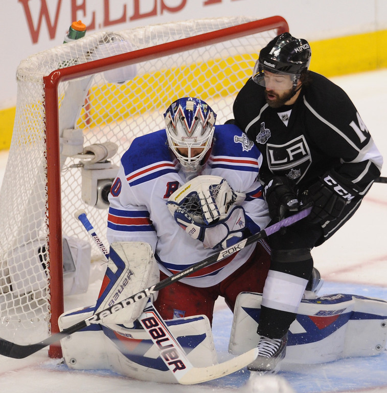 . Kings Justin Williams runs into Rangers goalie Henrik Lundqvist in the second period. The Los Angeles Kings faced the New York Rangers in game 1 of the Stanley Cup Finals. Los Angeles, CA. 6/4/2014(Photo by John McCoy / Los Angeles Daily News)
