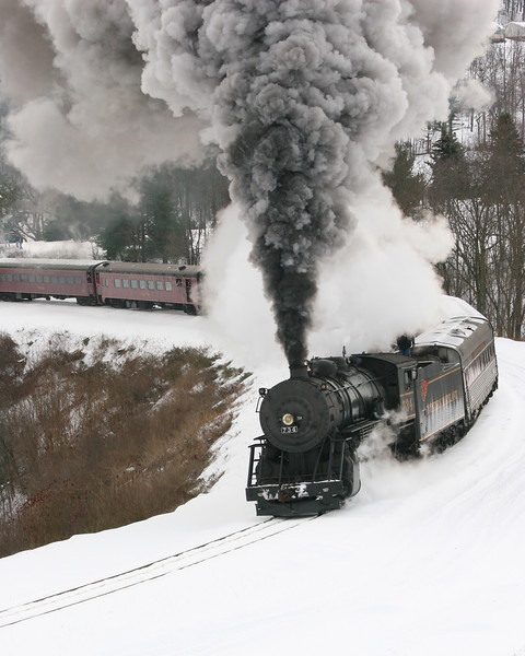 #734 round Helmstetter's Curve on a snowy December day Western Maryland Scenic Railroad