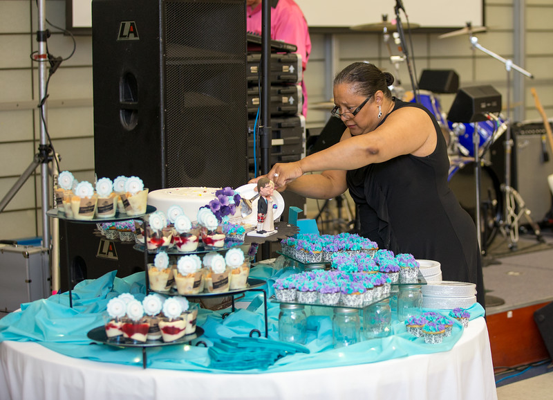 Wedding planner cutting the cake for guests.jpg