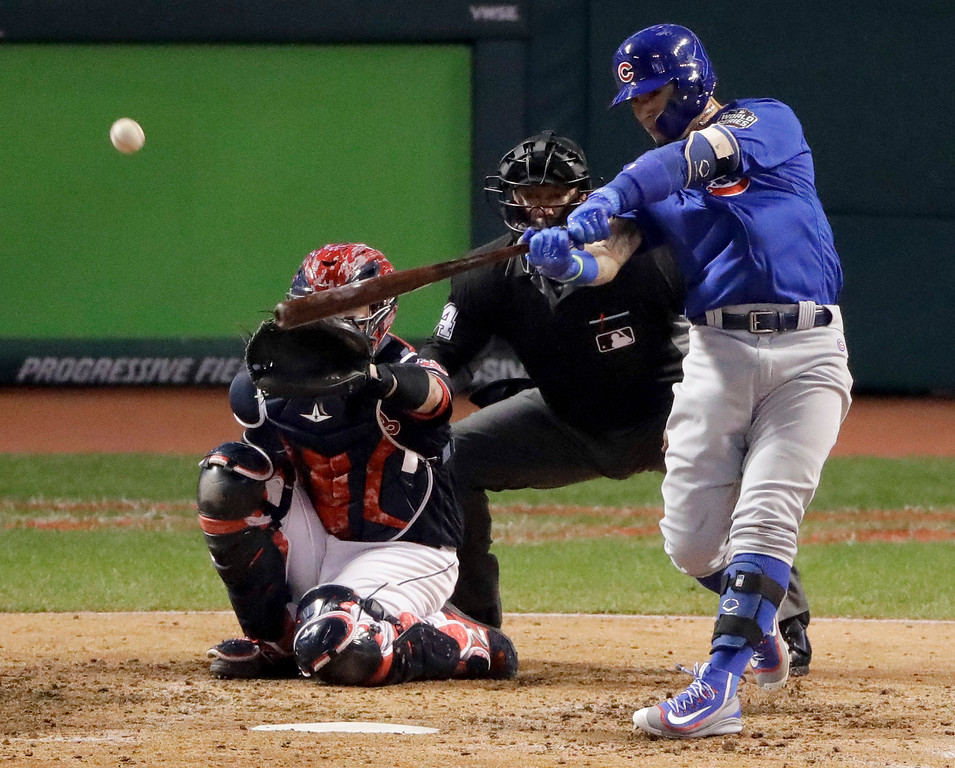 . Chicago Cubs\' Javier Baez hits a home run against the Cleveland Indians during the fifth inning of Game 7 of the Major League Baseball World Series Wednesday, Nov. 2, 2016, in Cleveland. (AP Photo/Charlie Riedel)