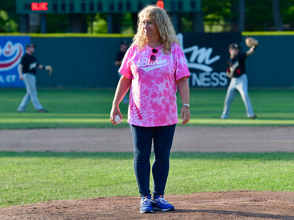8/1/2019 Mike Orazzi | Staff Cancer survivor Andrea Jablon throws out one of the first pitches during Pink Night at the Bristol Blues at Muzzy Field on Thursday evening.