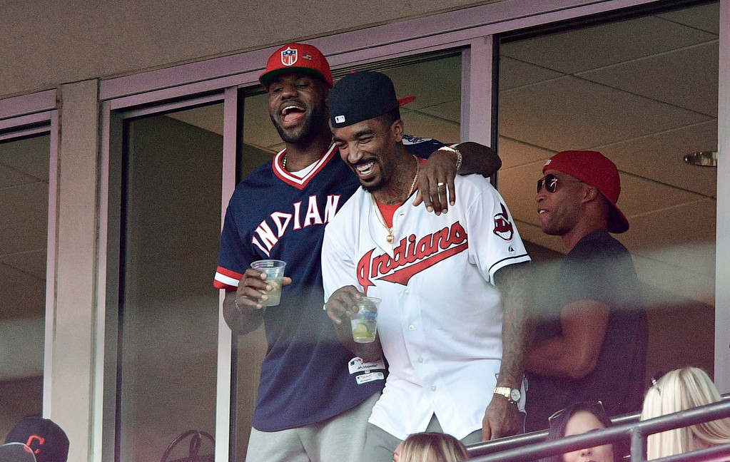 . Cleveland Cavaliers\' LeBron James, left, stands with J.R. Smith during the sixth inning of Game 2 of a baseball American League Division Series between the Cleveland Indians and the Boston Red Sox, Friday, Oct. 7, 2016, in Cleveland. (AP Photo/David Dermer)