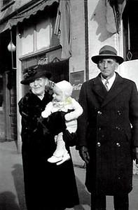 Carl J. Nelson, wife and grandchild.jpg