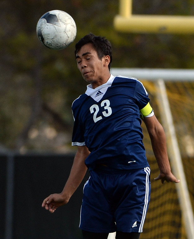. Baldwin Park\'s Javier Jasso with the header against Diamond Bar in the first half of a CIF-SS quarterfinal prep playoff soccer match at Diamond Bar High School in Diamond Bar, Calif., on Thursday, Feb.27, 2014. Baldwin Park won 2-1. (Keith Birmingham Pasadena Star-News)