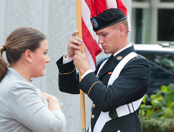 09/11/18 Wesley Bunnell | Staff New Britain unveiled its newest monument in Central Park which is dedicated to the War on Terror following the 9/11 attacks. Posting of the Colors was handled by the CT Air National Guardsman Michael Lozowski.