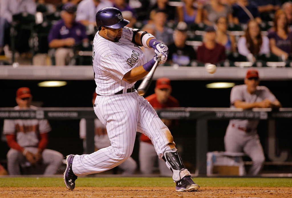 . DENVER, CO - SEPTEMBER 18:  Wilin Rosario #20 of the Colorado Rockies hits the game winning walk off two run home run off of Addison Reed #43 of the Arizona Diamondbacks at Coors Field on September 18, 2014 in Denver, Colorado. The Rockies defeated the Diamondbacks 7-6.  (Photo by Doug Pensinger/Getty Images)