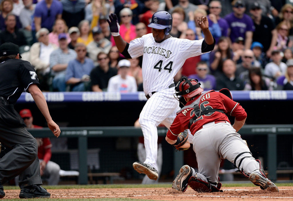 . DENVER, CO. - APRIL 21: Miguel Montero (26) of the Arizona Diamondbacks can\'t make the tag on Juan Nicasio (44) of the Colorado Rockies as he scores on a base hit by Jordan Pacheco in the third inning April 21, 2013 at Coors Field. (Photo By John Leyba/The Denver Post)