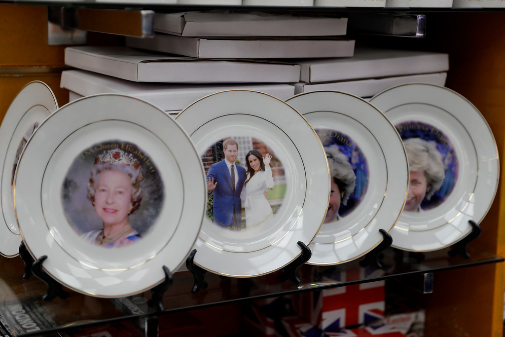 . A souvenir plate for the upcoming wedding of Britain\'s Prince Harry and Meghan Markle is displayed next to plates bearing images of his mother Princess Diana and his grandmother Queen Elizabeth II for sale in a shop in London, Wednesday, March 28, 2018. The wedding takes place on Saturday May 19 in Windsor Castle, England. (AP Photo/Matt Dunham)