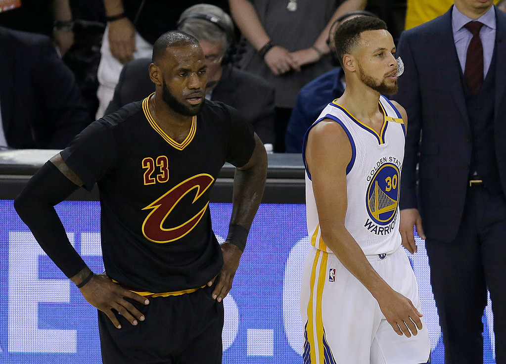 . Cleveland Cavaliers forward LeBron James (23) and Golden State Warriors guard Stephen Curry (30) during the first half of Game 5 of basketball\'s NBA Finals in Oakland, Calif., Monday, June 12, 2017. (AP Photo/Ben Margot)
