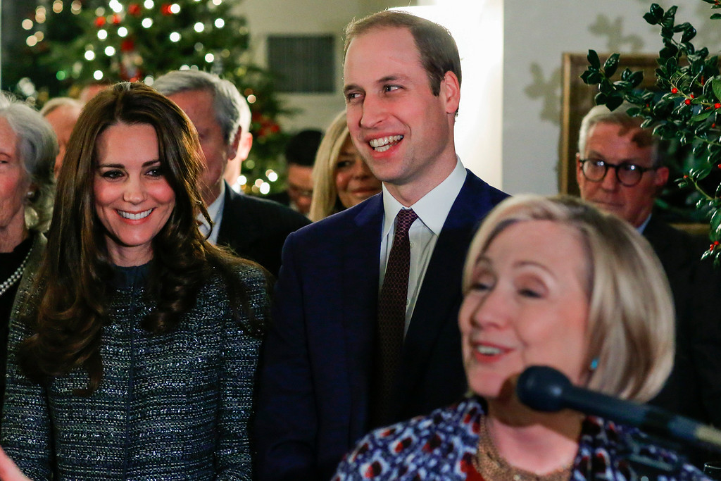 . Kate, the Duchess of Cambridge, left, and Britain\'s Prince William, the Duke of Cambridge, center, smile while they listen to Hillary Rodham Clinton during a reception co-hosted by the Royal Foundation and the Clinton Foundation at British Consul General\'s Residence, Monday, December 08, 2014 in New York.   (AP Photo/Eduardo Munoz Alvarez, Pool)