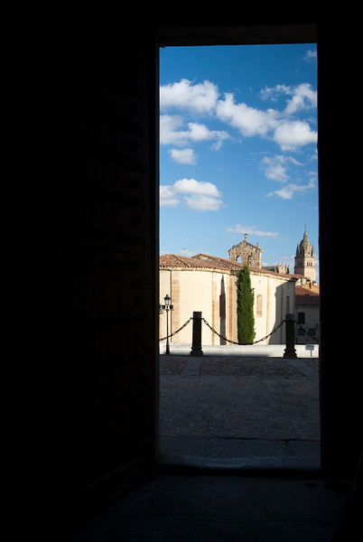 San Blas church (now auditorium) and Cathedral tower through the door of Fonseca college, town of Salamanca, autonomous community of Castilla and Leon, Spain