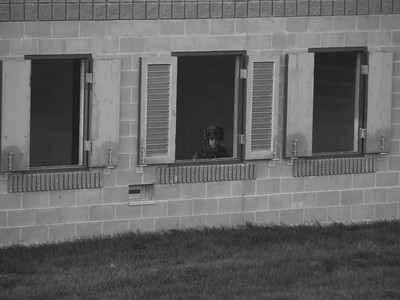 The Loneliness of War  Sentry posted after clearing the building. Exercise Arrowhead Storm 12, Meaford, Ontario, Canada.  Thanks, tried the one window but I felt it did not do what i was looking for in this picture. He looks a lot less lonely with only one empty window. I was quite a distance away on the second floor of another building set back and partially hidden, he still had eyes on!