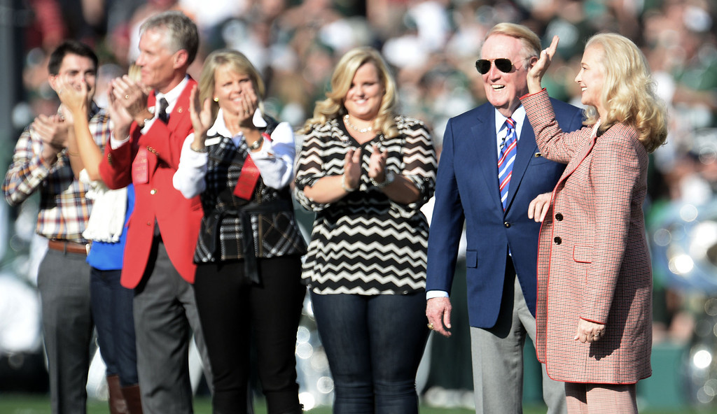 . Rose Parade grand marshal Vin Scully, second from right, with his wife Sandy, right, prior to the 100th Rose bowl game between Stanford and Michigan State in Pasadena, Calif., on Wednesday, Jan.1, 2014. 