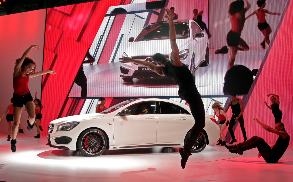 Description of . Members of the Alvin Ailey II dance troupe perform during the presentation of the the 2014 CLA 45 AMG Mercedes Benz is presented at the New York International Auto Show, in New York's Javits Center,  Wednesday, March 27, 2013. (AP Photo/Richard Drew)