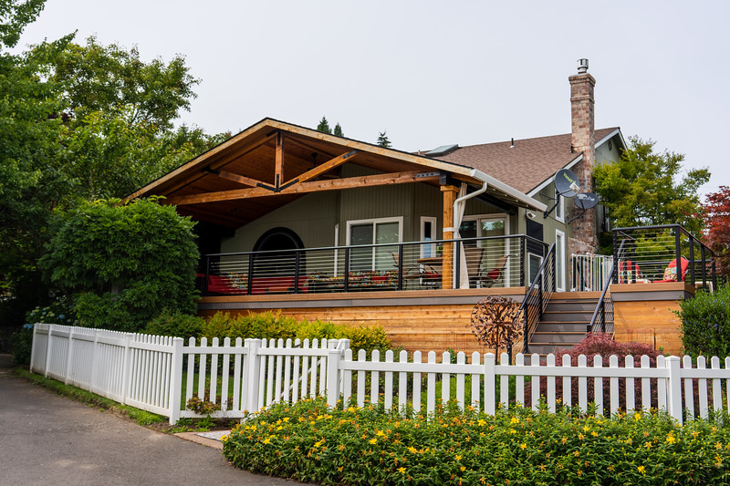 Wood Framed Cover with Aluminum Cable Railing and White Picket Fence