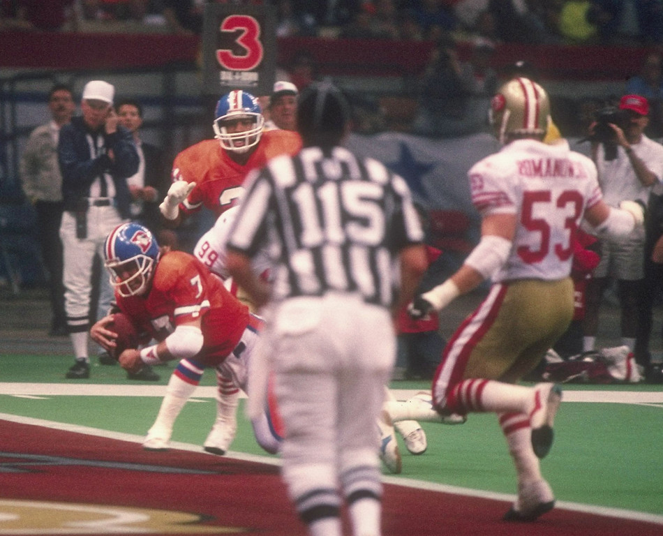 . 28 Jan 1990:  Quarterback John Elway of the Denver Broncos scores a touchdown during Super Bowl XXIV against the San Francisco 49ers at the Superdome in New Orleans, Louisiana.    (Rick Stewart/Allsport)