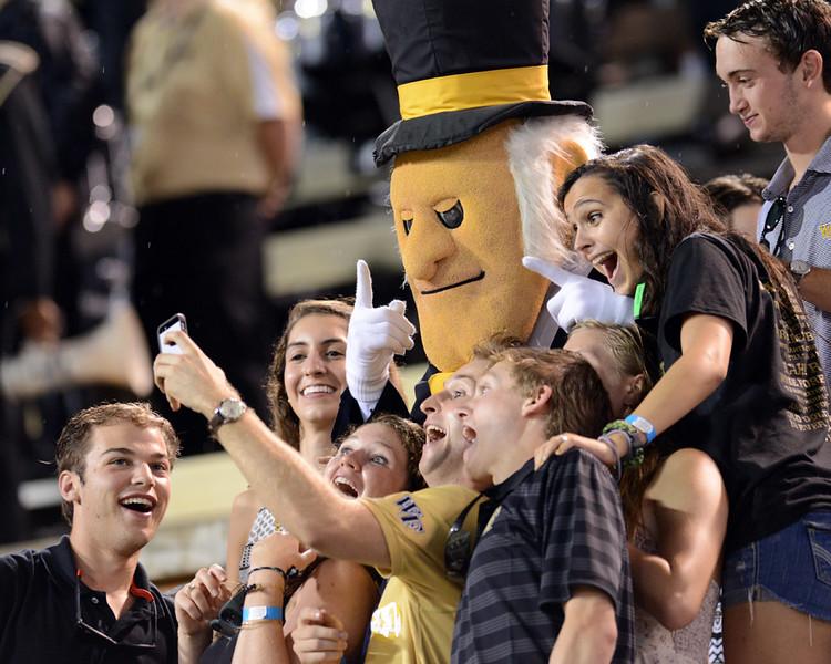 Students take selfie with Deacon.jpg