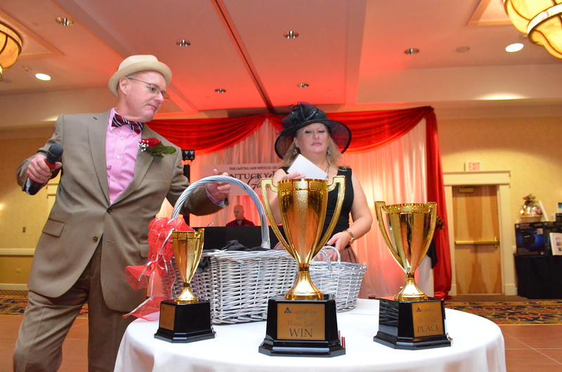 Three trophies for the best hats.