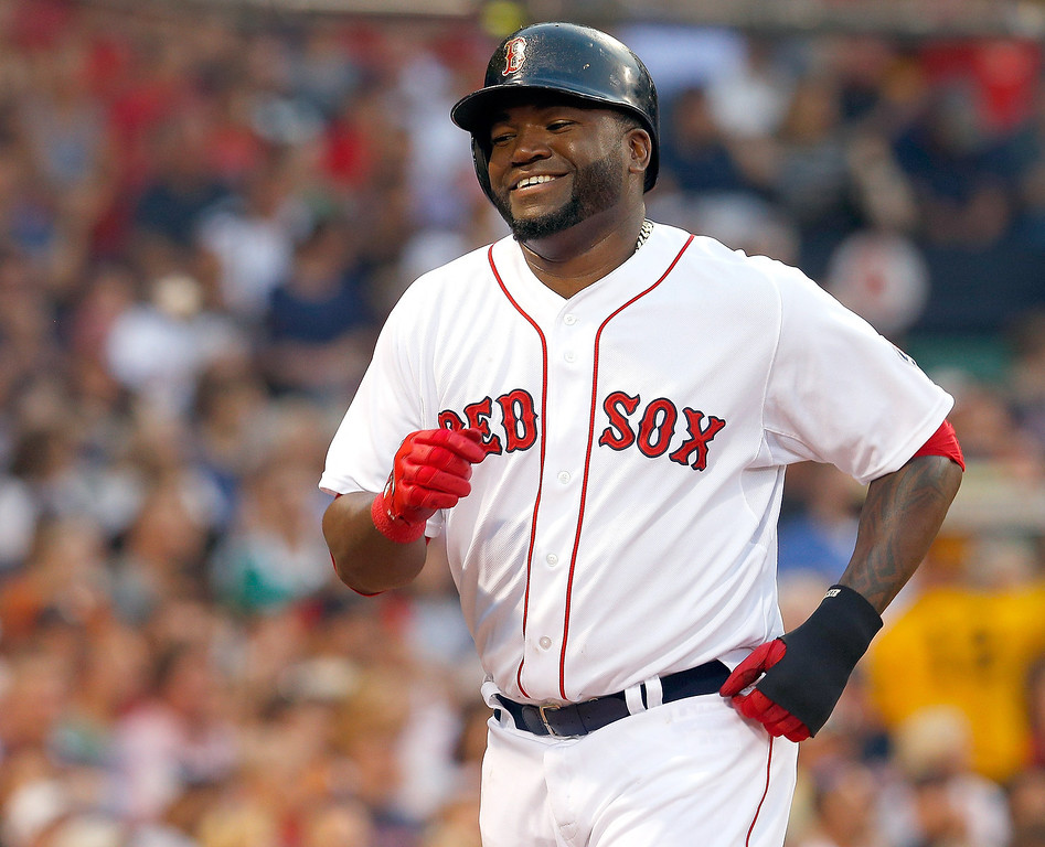 . David Ortiz #34 of the Boston Red Sox smiles after scoring a run against the Colorado Rockies in the 2nd inning at Fenway Park on June 25, 2013 in Boston, Massachusetts.  (Photo by Jim Rogash/Getty Images)