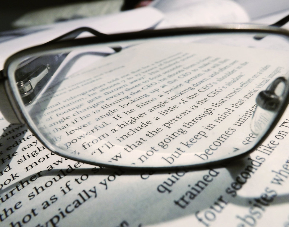 . This photograph of my glasses on a book, at the time I was studying for my exam for medical interpreter training. It shows my personality too and my physical appearance kind of, cause, I�m wearing glasses. It shows that I�m a studious person too. It�s kind of like a self-portrait. I feel really blessed and very lucky to be here because we have enough resources and a lot of opportunities for me to go to college and to school. In Burma, those kind of opportunities don�t really exist. There are a lot of child laborers too.  It was poor. The government, they don�t really encourage opportunities to go to school. Most children end up being in farms and doing hard work. They support their families. It is priority goal in Burma. Survival is number one in Burma.   (Photograph by Isaiah Gwa)