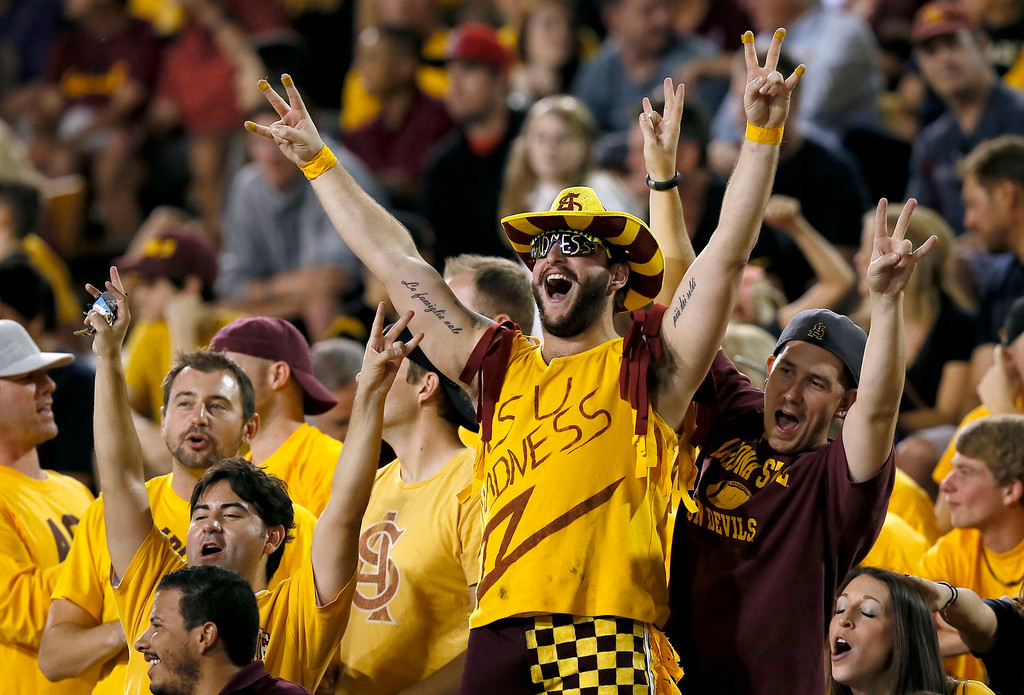 . Arizona State fans cheer after an early touchdown against Colorado during the first half of an NCAA college football game on Saturday Oct. 12, 2013, in Tempe, Ariz. (AP Photo/Ross D. Franklin)