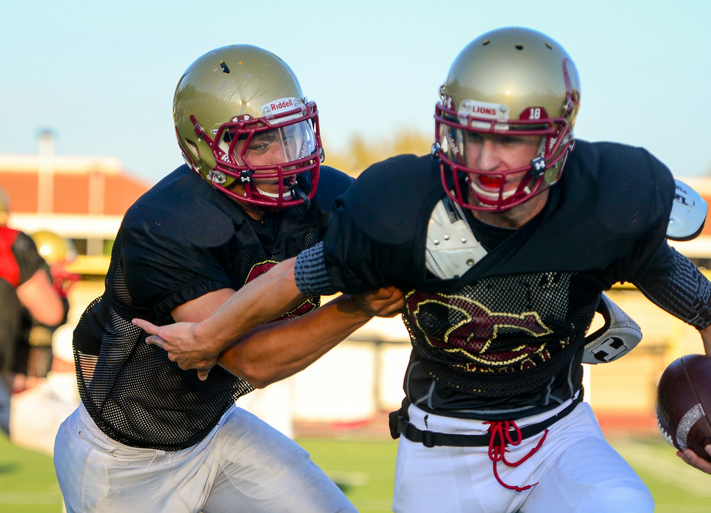 . Oaks Christian DE Trevor Howard chases down a QB at practice, Wednesday, August 20, 2014. (Photo by Michael Owen Baker/Los Angeles Daily News)