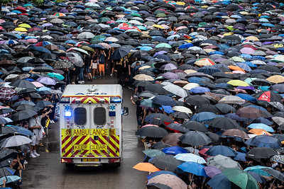 Thousands of pro-democracy protesters took to the streets on August 19, 2019 in Hong Kong. Despite the huge number of people, the crowd parted quickly to allow an ambulance to get through.