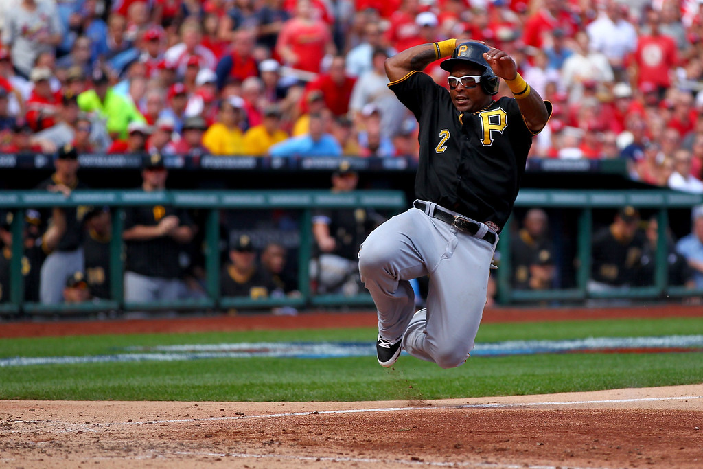 . ST LOUIS, MO - OCTOBER 04:  Marlon Byrd #2 of the Pittsburgh Pirates slides home to score a run in the seventh inning against the St. Louis Cardinals during Game Two of the National League Division Series at Busch Stadium on October 4, 2013 in St Louis, Missouri.  (Photo by Dilip Vishwanat/Getty Images)