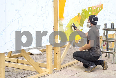 artist-live-paints-rainforestthemed-murals-each-day-of-the-east-texas-state-fair