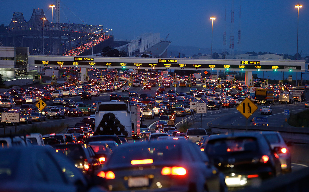 . Commuters wait to pay their tolls on the San Francisco-Oakland Bay Bridge, Monday, July 1, 2013, in Oakland, Calif. (AP Photo/Ben Margot)