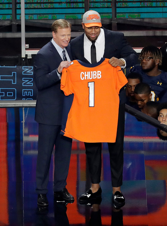 . Commissioner Roger Goodell, left, presents North Carolina State\'s Bradley Chubb with his Denver Broncos jersey during the first round of the NFL football draft, Thursday, April 26, 2018, in Arlington, Texas. (AP Photo/Eric Gay)