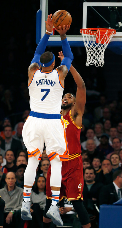 . New York Knicks forward Carmelo Anthony (7) shoots over Cleveland Cavaliers center Tristan Thompson (13) in the first quarter of an NBA basketball game at Madison Square Garden in New York, Wednesday, Dec. 7, 2016. (AP Photo/Kathy Willens)